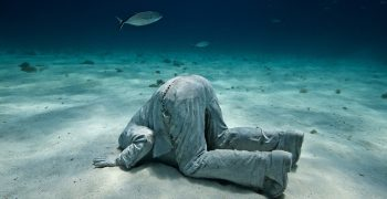 The banker - a sculpture by Jason Decaires Taylor in Maxico